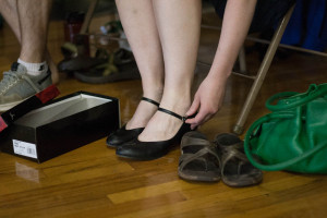 Dancing shoes are often strapped on before contra dancing (but not required).